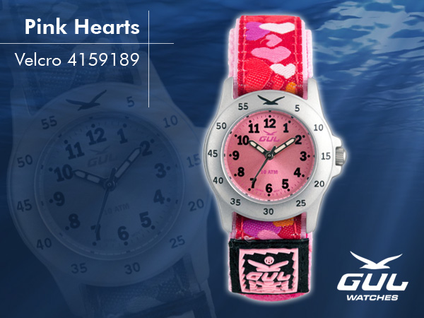 Pink face with pink/white heart velcro strap. Hardened mineral glass, Size 28 mm, Stainless steel front and titanium back case, Waterproof 10 ATM - 100 m, Miyota quartz movement.