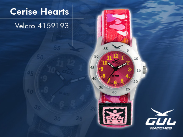 Red face with pink/white heart velcro strap. Hardened mineral glass, Size 28 mm, Stainless steel front and titanium back case, Waterproof 10 ATM - 100 m, Miyota quartz movement.